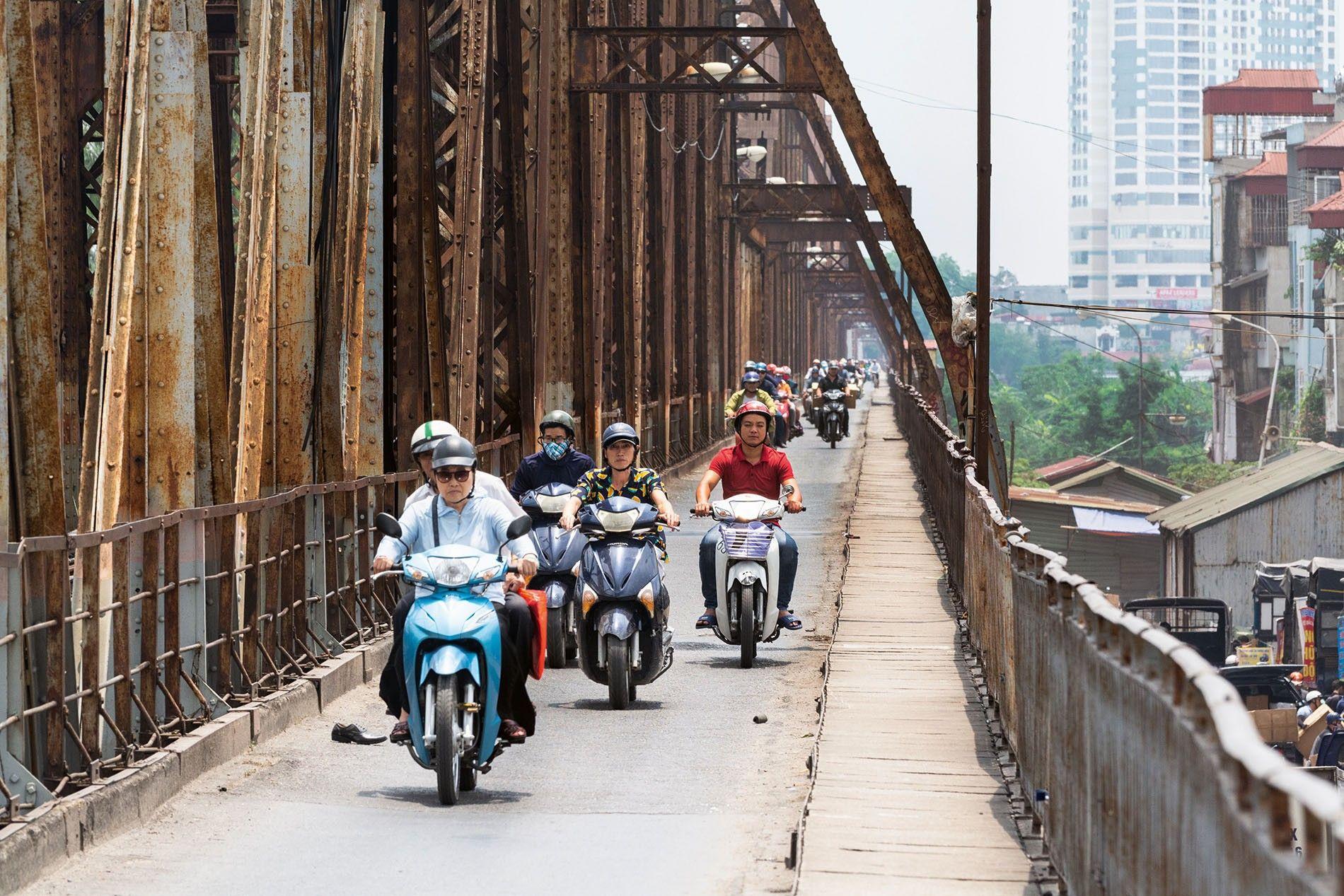 Scooters crossing Long Bien Bridge, Hanoi