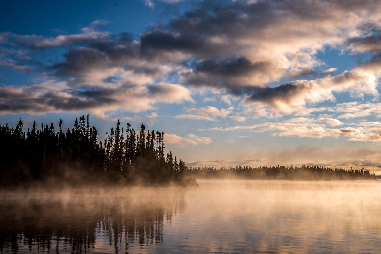 Early morning mist over Lake Opemisca, Ouje-Bougoumou, Québec.