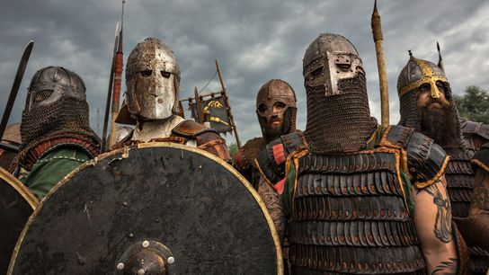 Reenactors don armor in preparation for close combat during the Festival of Slavs and Vikings in ...