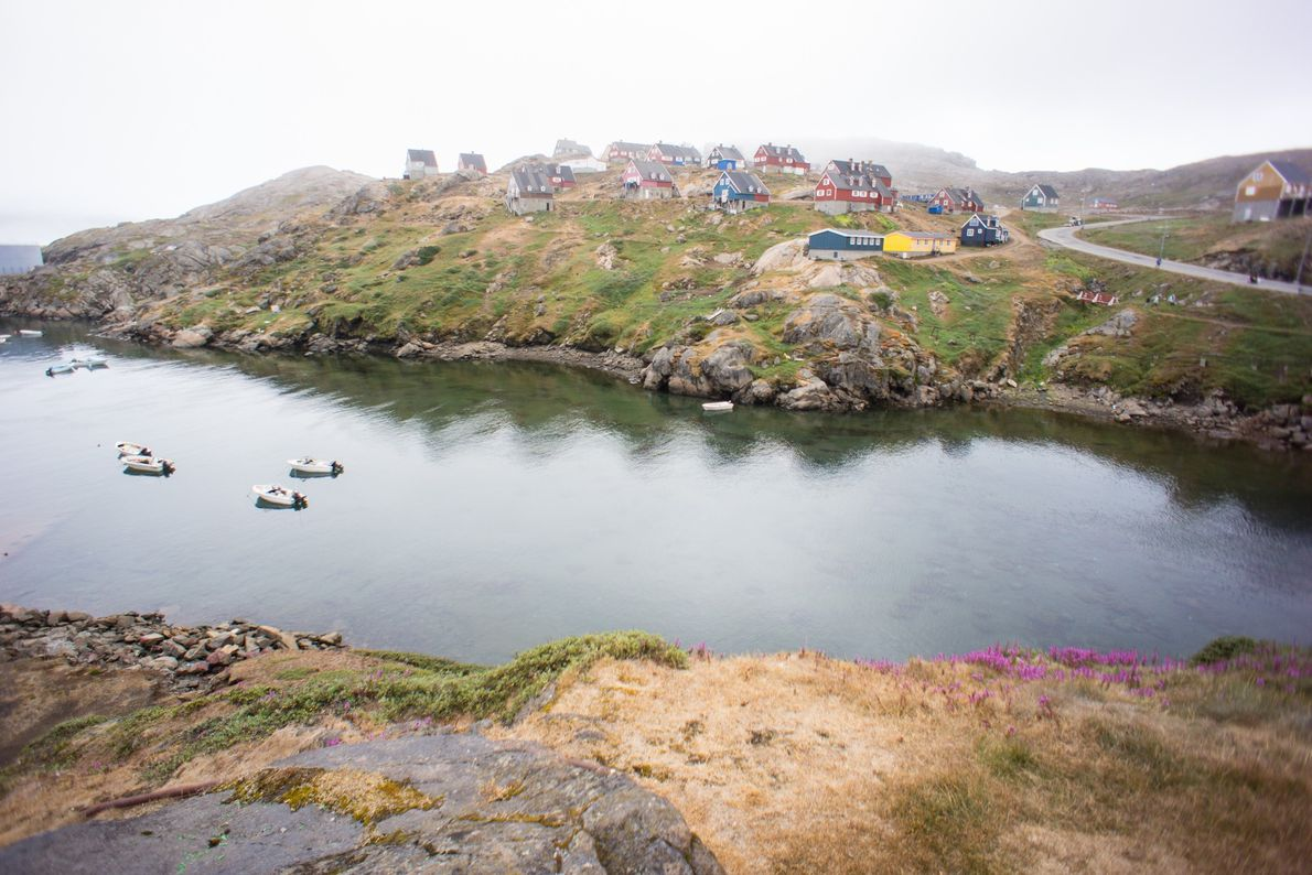 Colourful, Scandinavian-inspired homes pepper the coast of a community in southeastern Greenland.