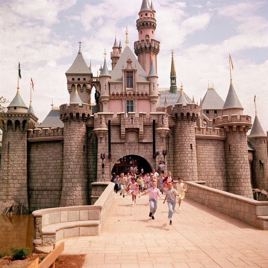 Children run through Sleeping Beauty's Castle, located at the heart of Disneyland. The design is based ...