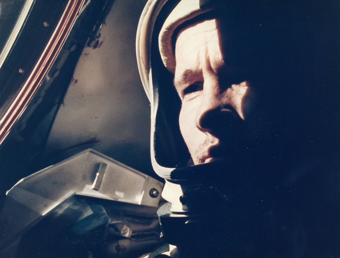 Astronaut Ed White poses for the first in-flight portrait, taken by astronaut James McDivitt in 1965 ...