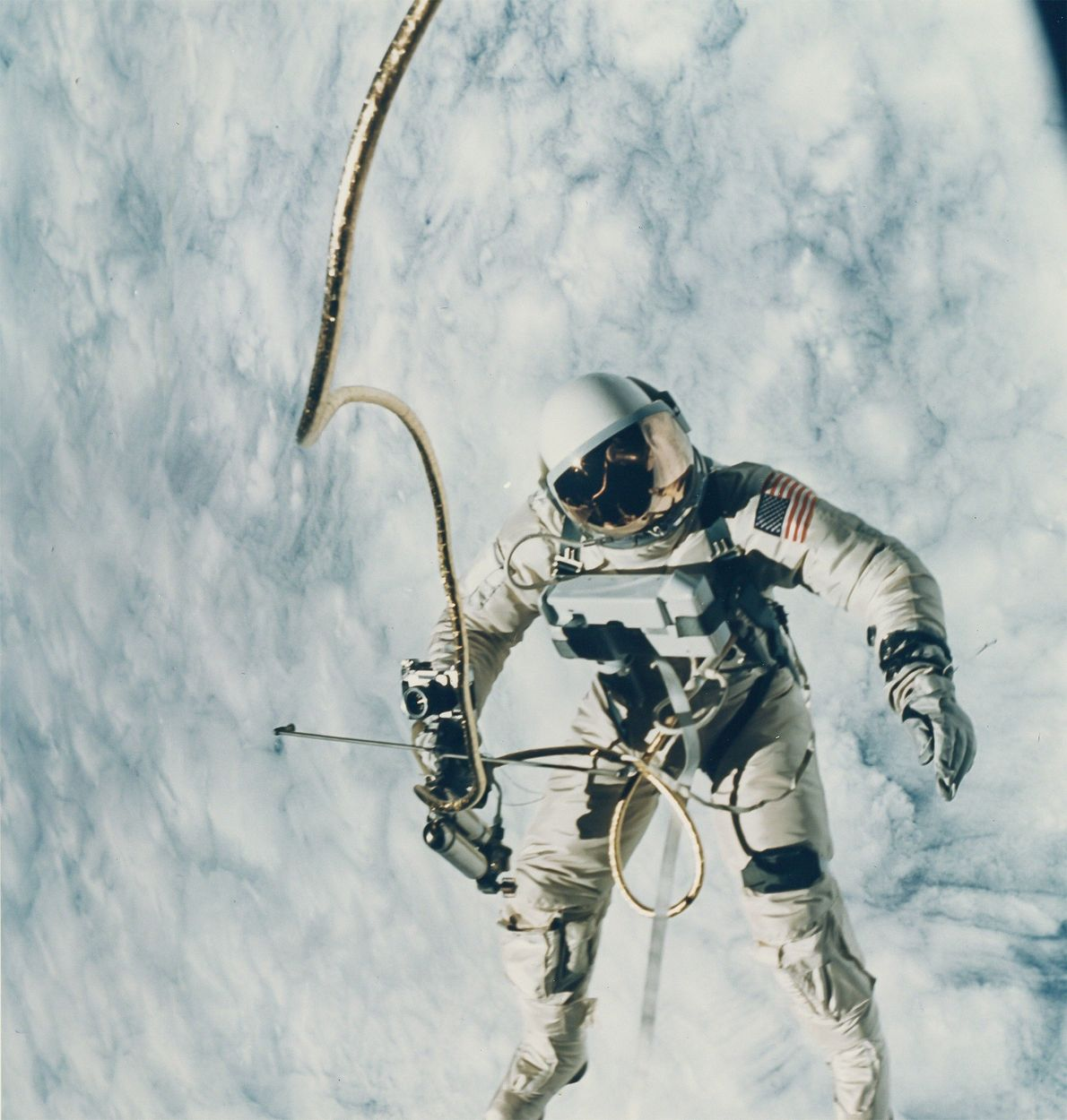 Ed White floats outside the Gemini 4 in a 1965 photo taken by fellow astronaut James ...