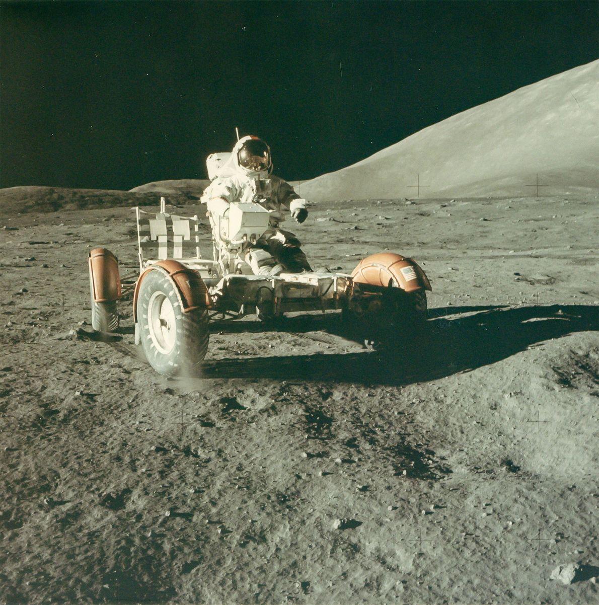 Astronaut Eugene Cernan tests the lunar rover on the moon. His Apollo 17 partner Harrison Schmitt ...
