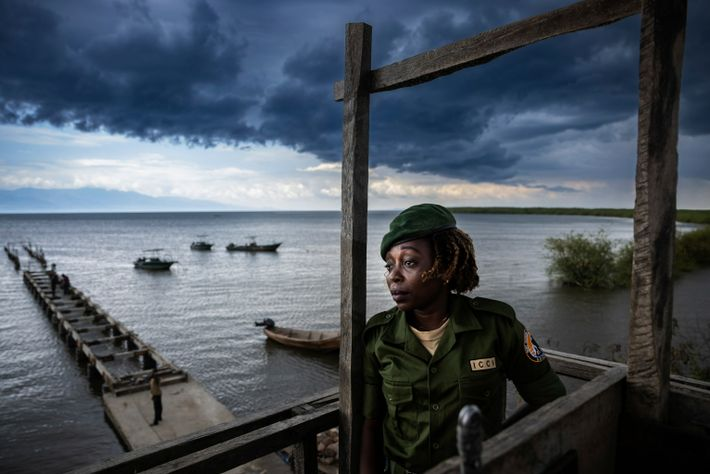 Conservation ranger Chantal Kahinda Vinywa keeps watch from her observation post on Lake Edward. The rangers ...