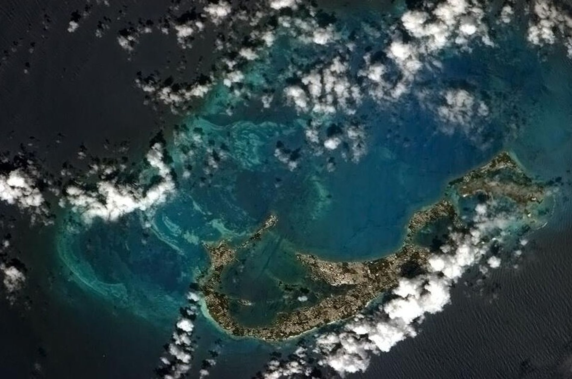 The island of Bermuda, seen here from the International Space Station, sits on the husk of ...