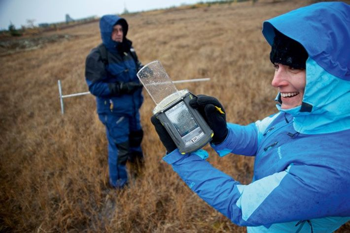 Permafrost probing and data recording on the tundra, Canada.