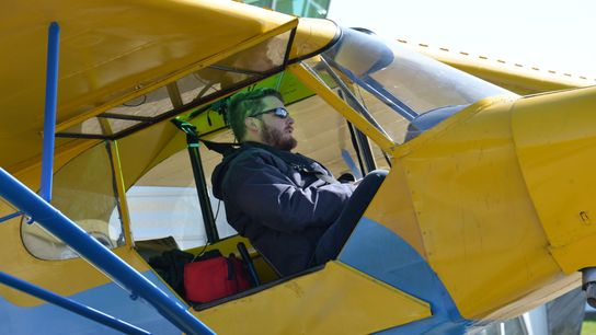 Garrett Fisher flies a70-year-old Piper PA11 plane, with no electrical instrument or GPS, to get aerial ...