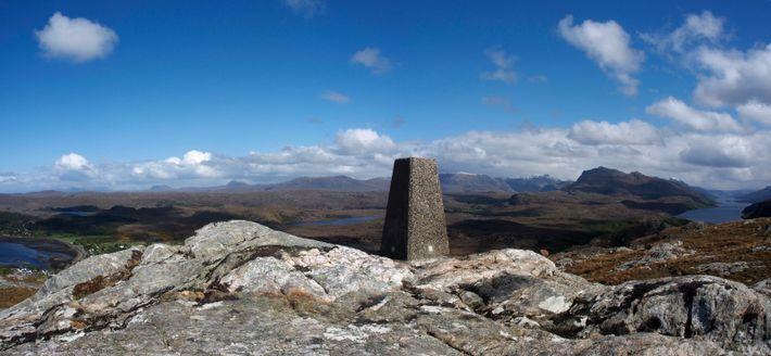 A trigonometrical (trig) pillar on the top of Cliff Hill, near Poolewe, Scotland. Pillars such as ...