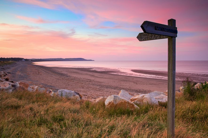 Ramsey Beach on the Isle of Man at sunset. The island has nearly 100 miles of ...