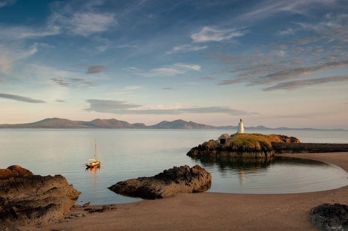 Llanddwyn Island sits of the southwest coast of Anglesey in North Wales. To reach it, you ...