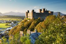 Edward I's mighty coastal fortress of Harlech, in Gwynedd, crowns a spectacular rocky outcrop overlooking dunes far below.