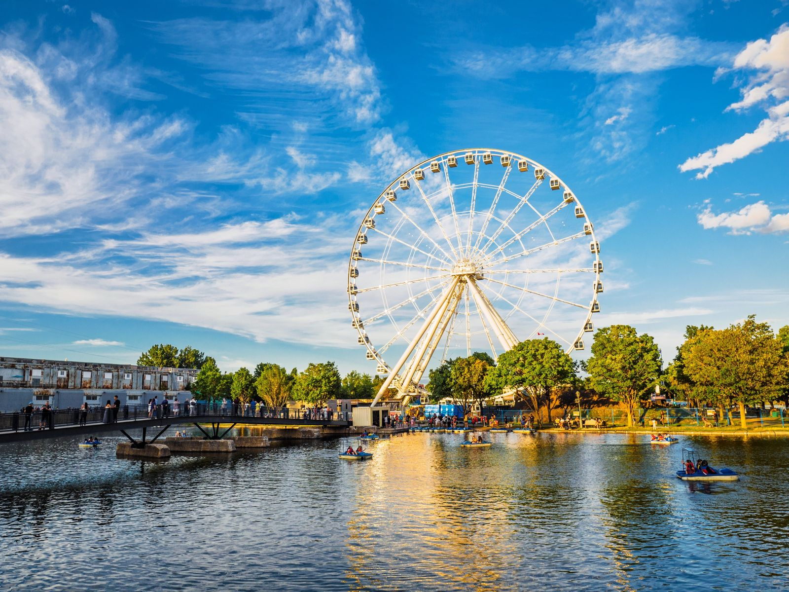 City waterfront park in Old Montreal with view of La Grande Roue de Montreal (Observation Wheel).