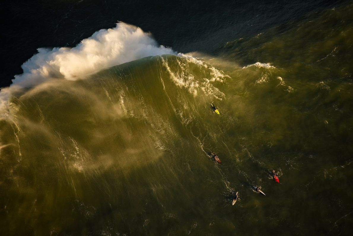 Surfers compete in the Titans of Mavericks surf competition at Half Moon Bay, California.