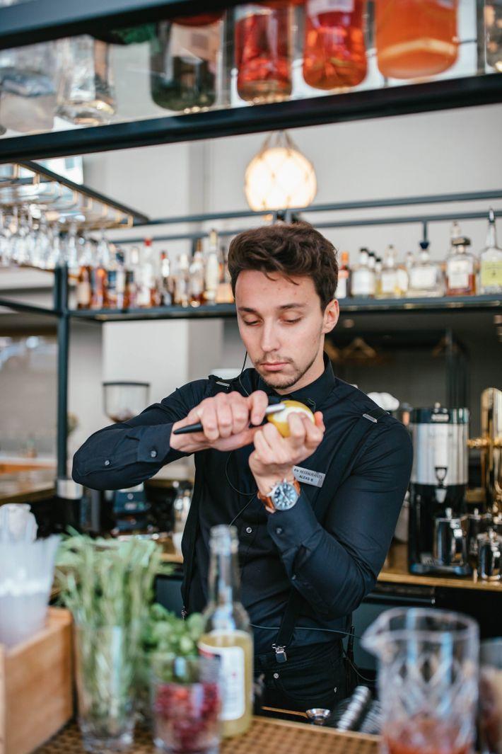 A bartender making a cocktail at Bronda.