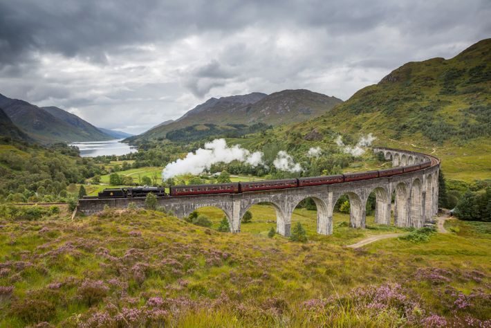 The Jacobite Steam Train passing over the Glenfinnan Viaduct, north of Loch Shiel.