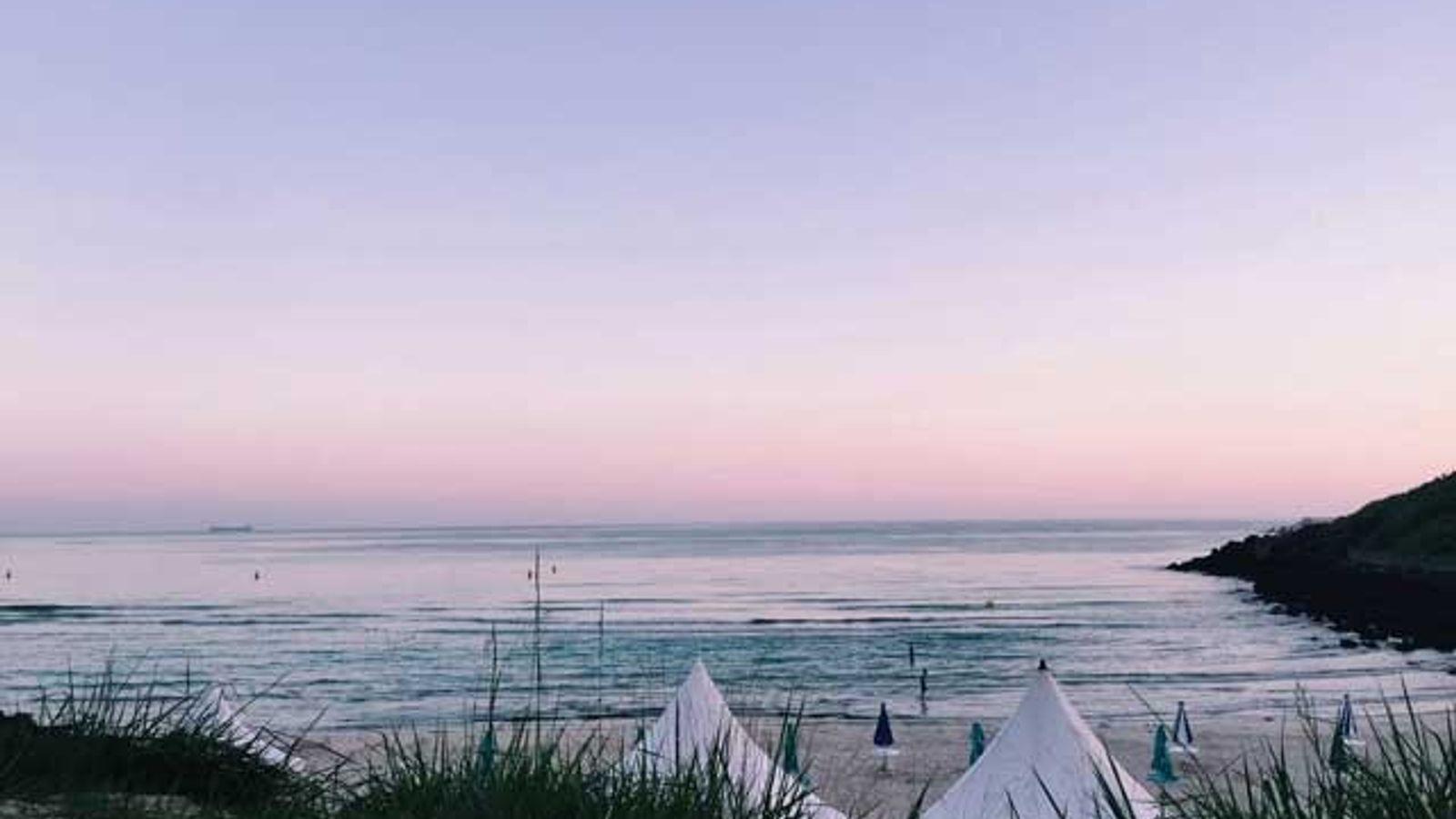 Pink skies at Hamdeok Beach.
