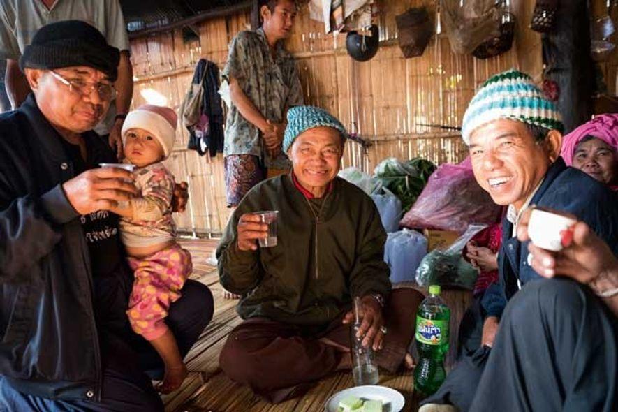 Wedding guests enjoying moonshine in Ban Muang Pam. Image: Slawek Kozdras