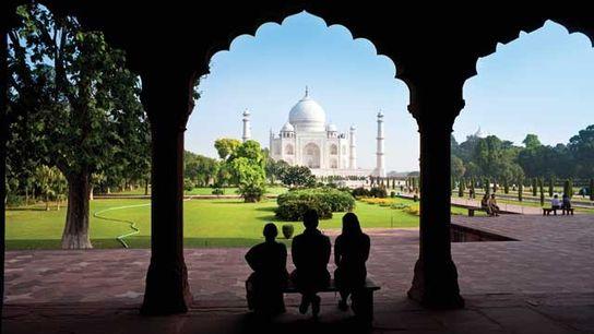 Taj Mahal through a decorative stone archway