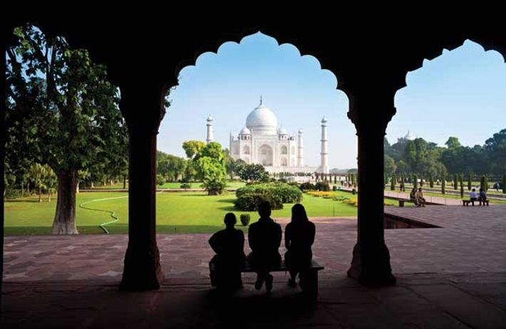Taj Mahal through a decorative stone archway