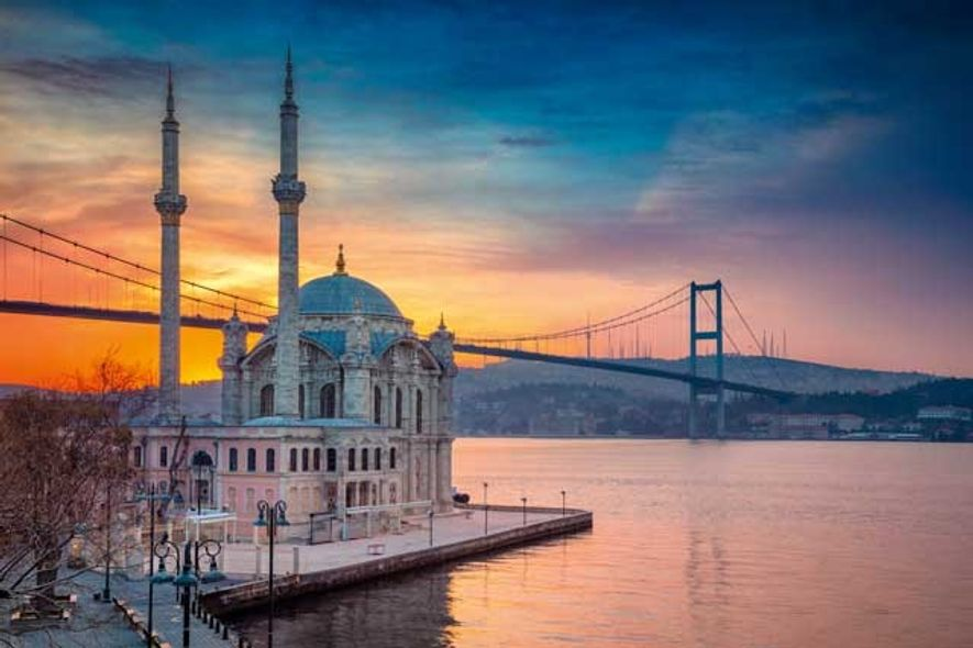 Sunset over Ortaköy Mosque, with the Bosphorus Bridge in the background. Image: Getty
