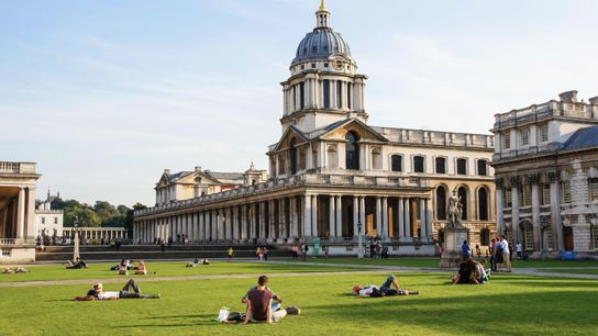 Londoners unwind on the sunny lawns outside the Old Royal Naval College. The 18th-century baroque complex, ...