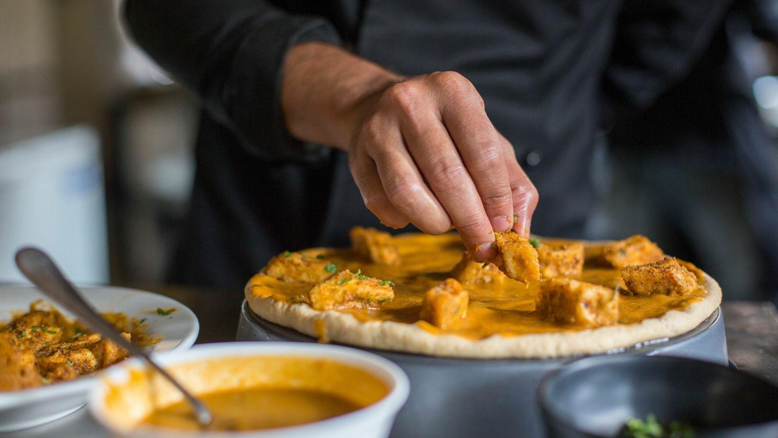Vegan cheese pizza with tofu and house sauce at Carrots restaurant, Bengaluru.