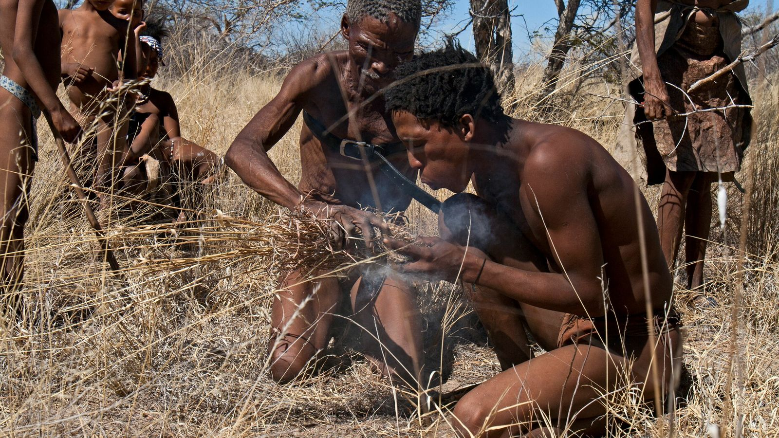 A Ju/'hoansi (San Bushman) cultural guides demonstrates the traditional way to make fire, Nyae Nyae Conservancy, ...