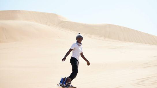 Sandboarding down the dunes in Swakopmund.
