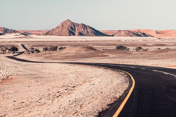 Road stretching towards Sossusvlei, in the Namib desert.