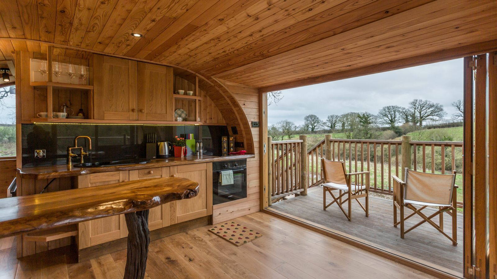 Cheriton Treehouse is a leafy, luxurious hideaway wrapped around an oak tree in the Somerset countryside.