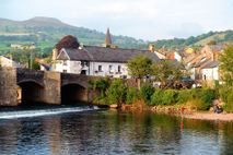 Usk Bridge and The Bridge End Inn, Crickhowell, with Table Mountain in the background. It may not ...