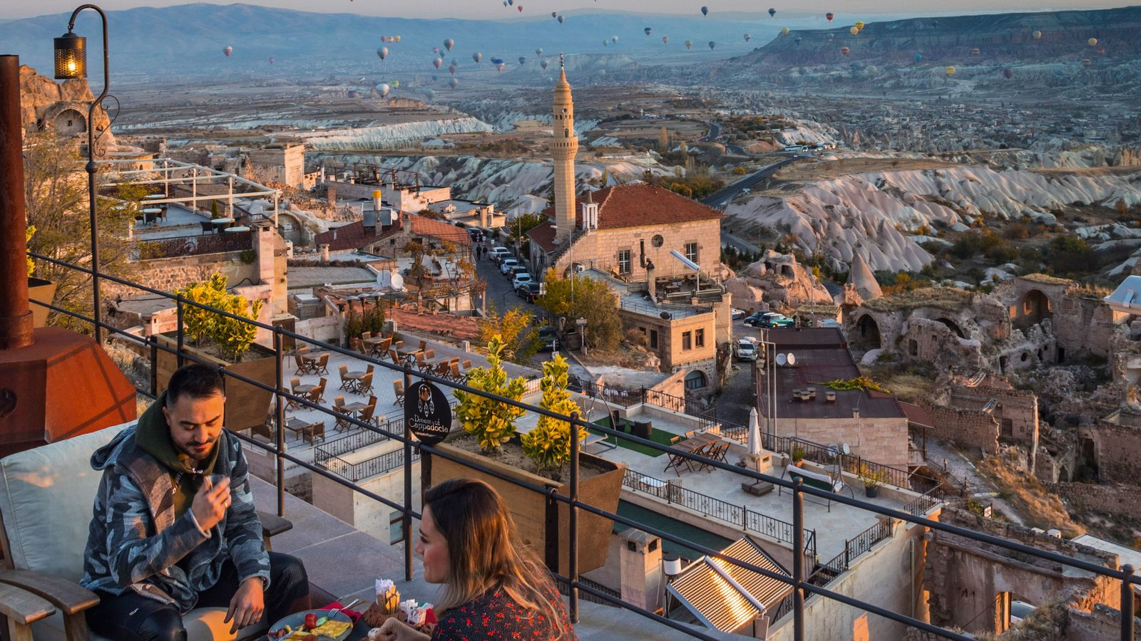 Hot air balloons take flight above Uçhisar.