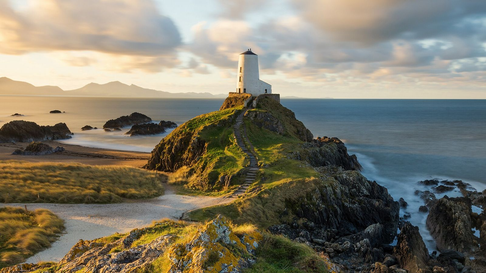 Morning light at Llanddwyn Lighthouse, on the south coast of Anglesey.