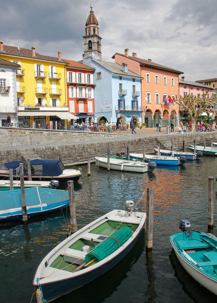 Pastel-coloured buildings lining Ascona's promenade