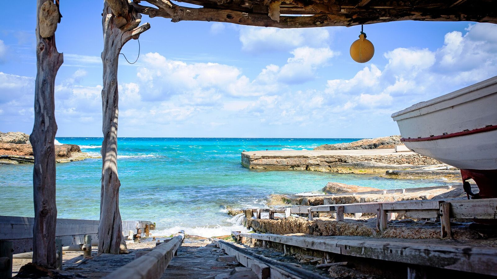 Es Caló de Sant Agustín is a traditional fishing village in Formentera, with wooden boathouses, a ...