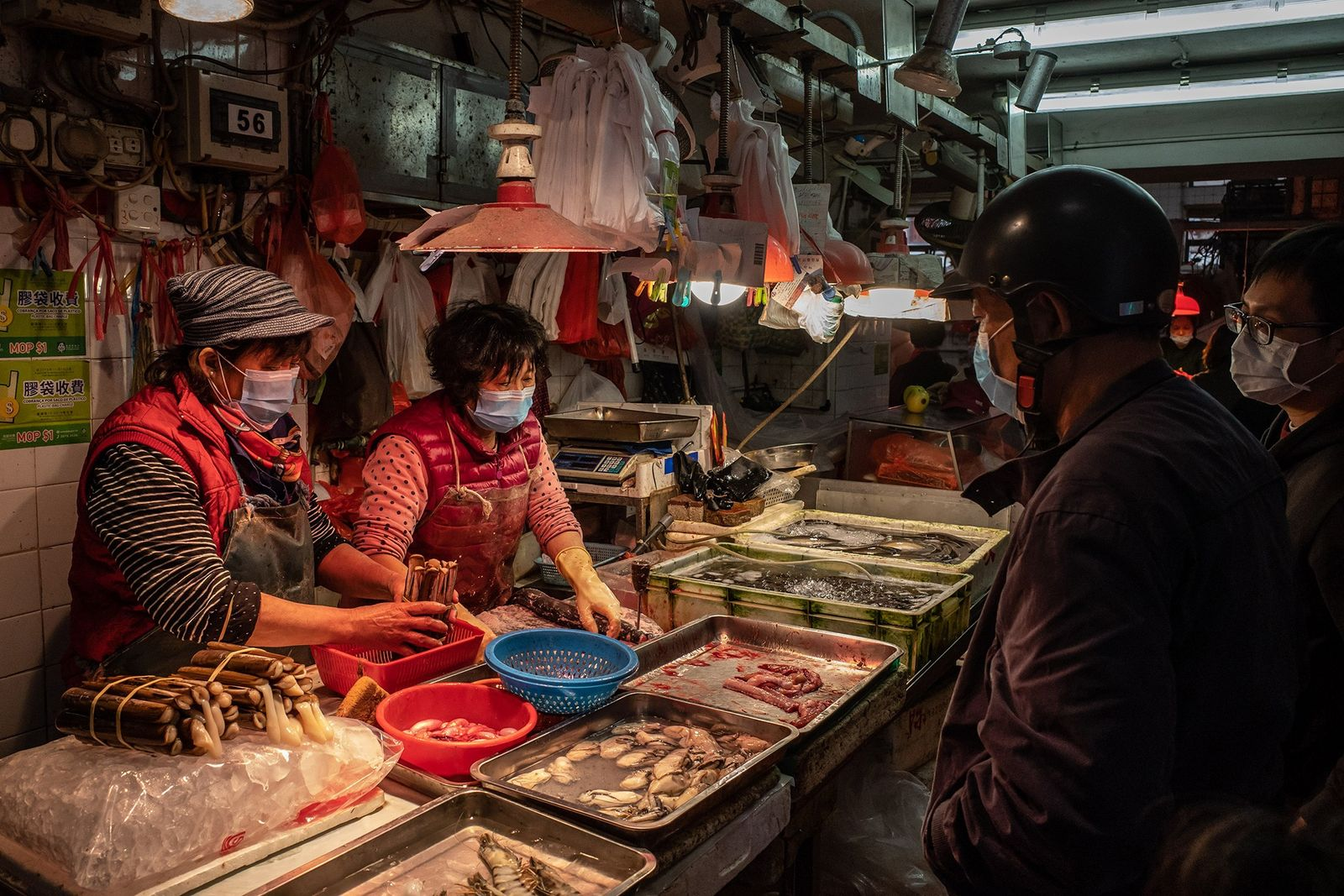 Wet markets, like this one in Macau, are found throughout Asia and sell fresh vegetables, fruit, ...