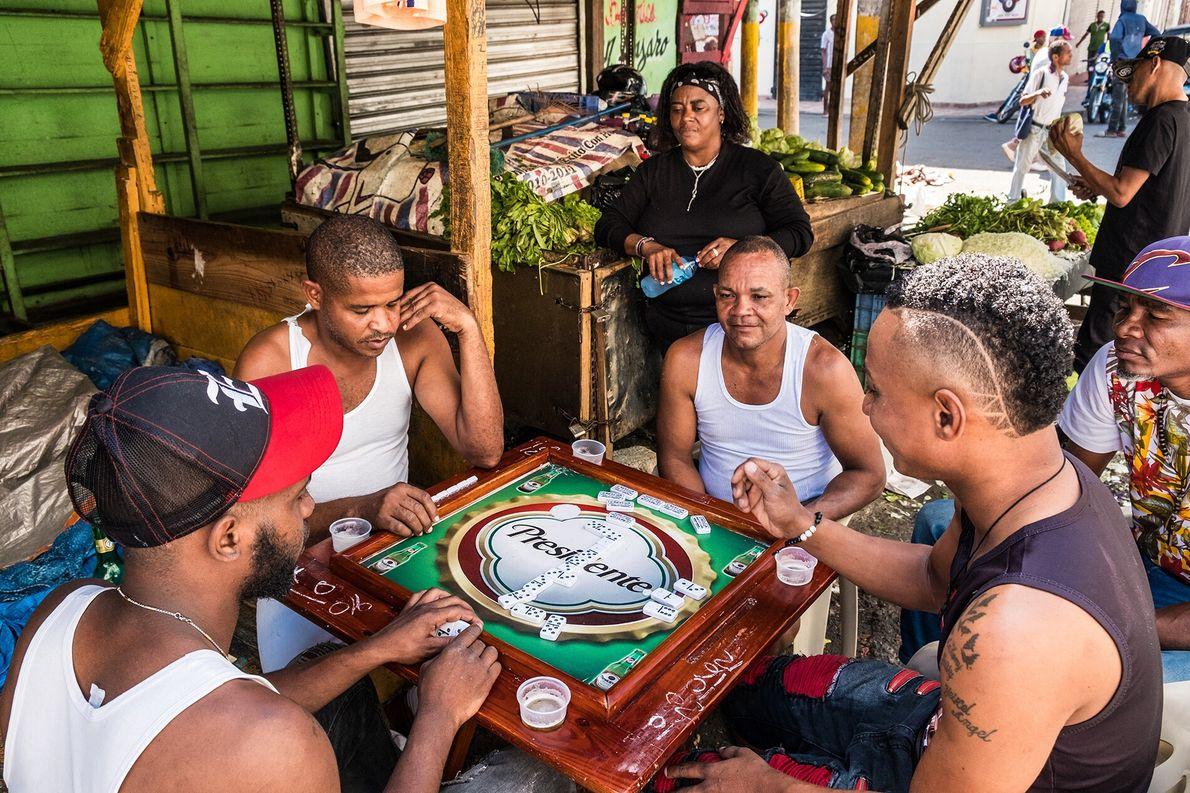 Domino games are a common sight around La Capital — as Santo Domingo is also known ...