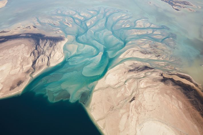 Aerial shot of Khor Al Udaid, also known as the Inland Sea, one of the few places ...
