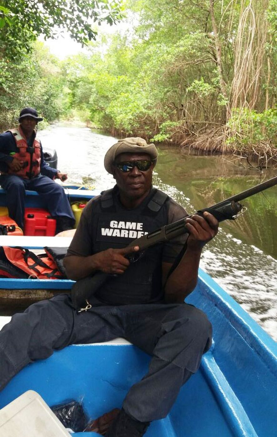 Nicholas Leith, armed and on patrol in the Caroni Swamp, has been a game warden for roughly 18 ...
