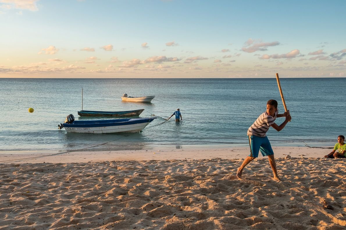 Come sundown, the community of Punta Rucia gathers on the sand to play sports or while ...