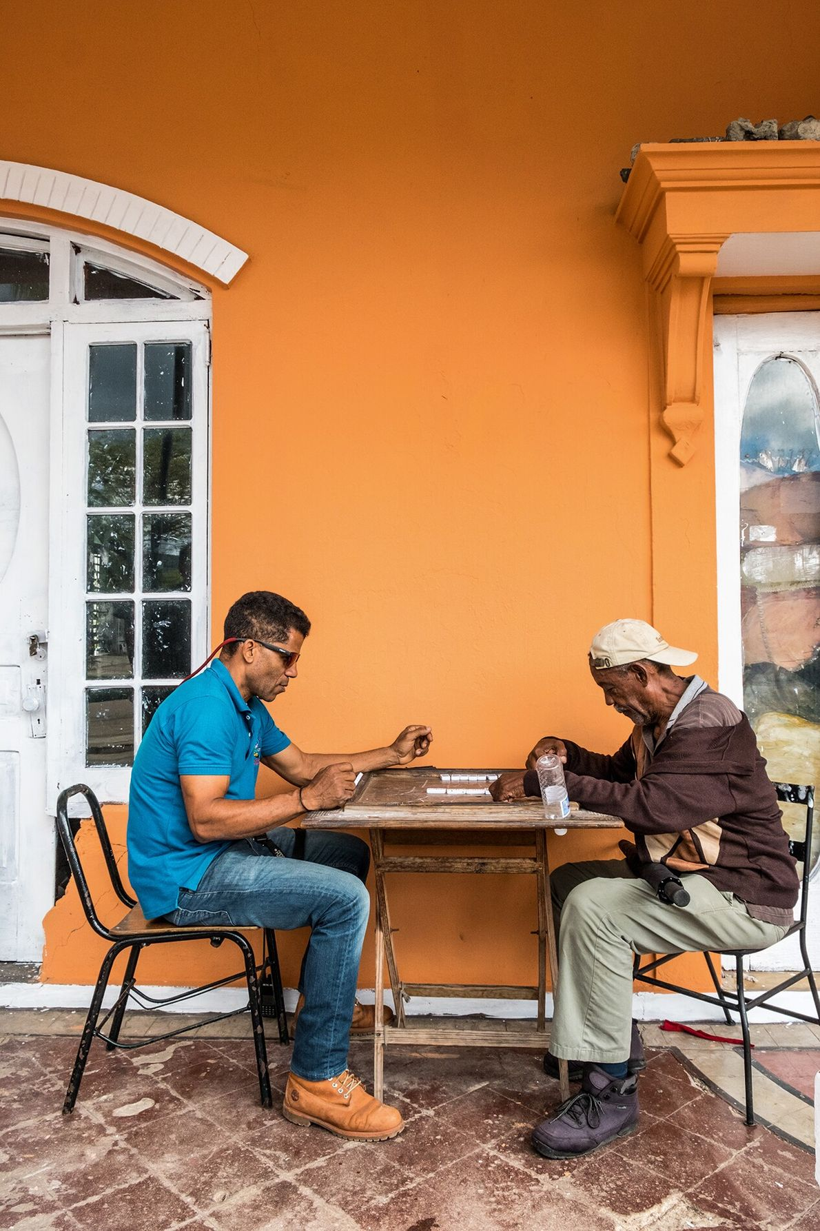 Locals focus on a game of dominoes in Puerto Plata's colonial-era centre. Resting between verdant Mount ...