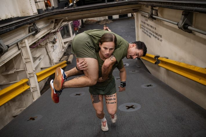 Marines have to be able to carry one another if necessary. USMC Cpl. Gabrielle Green hefts ...
