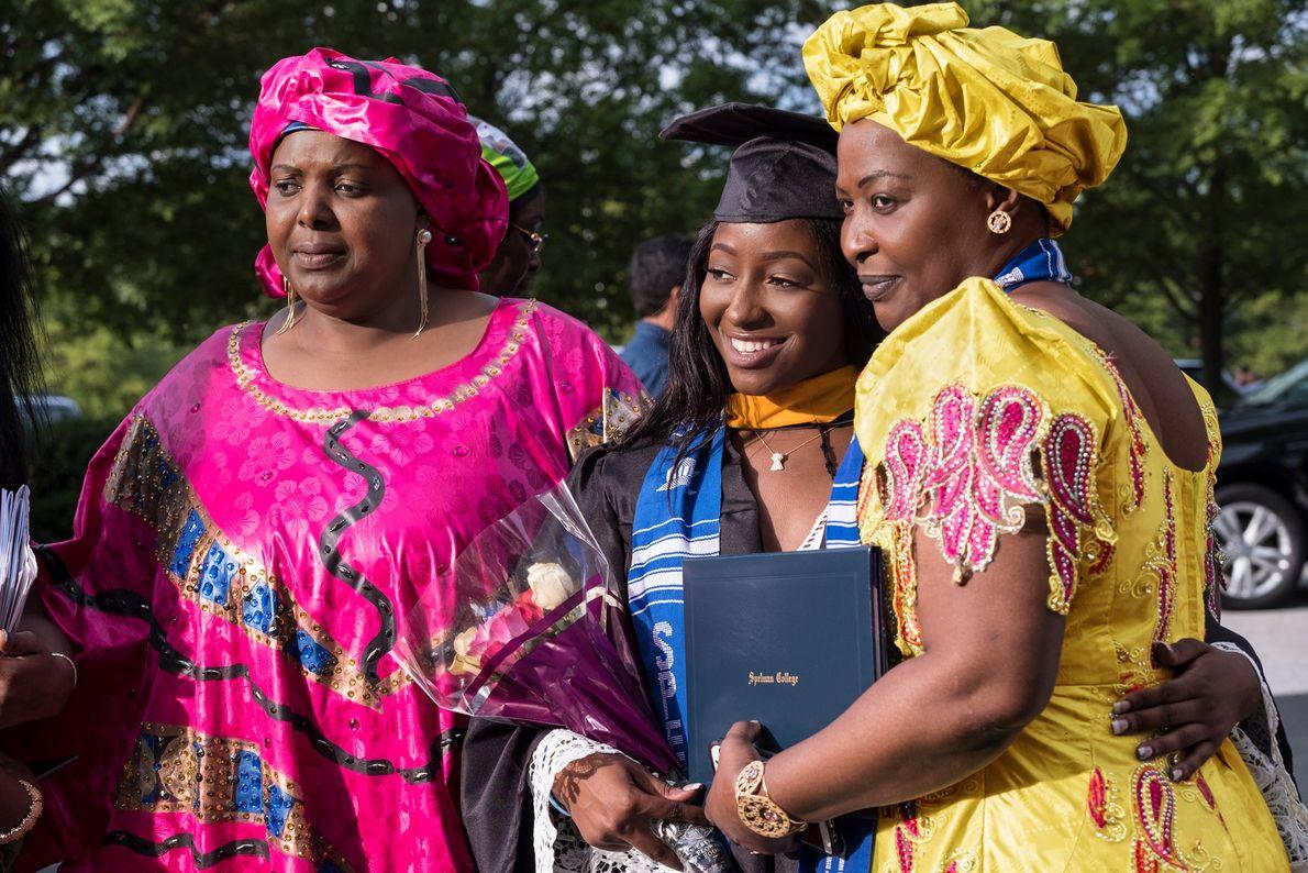 2017, GEORGIA   Nanmanian Camara, an aspiring dentist, celebrates with her aunt, Mamata Soumah (left), and ...
