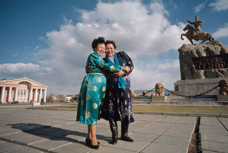 2007, MONGOLIA | A pharmacist (at right) beams as she meets her hero, a widely admired ...