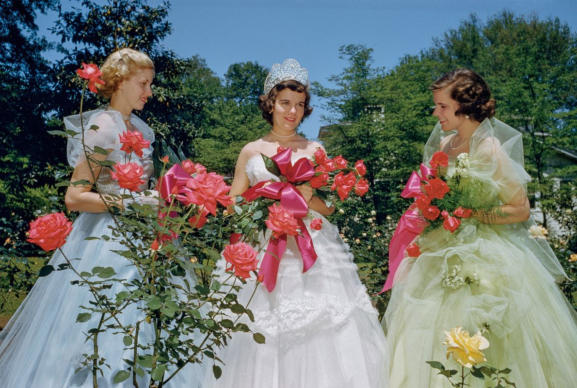 1953, GEORGIA | At the annual rose show in Thomasville, Georgia, a festival queen and her ...