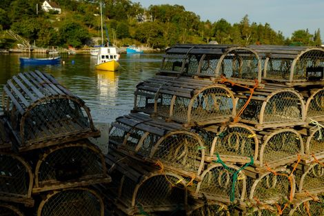 Wooden lobster traps stacked in Boutiliers Cove along Nova Scotia's Lighthouse Route. The most commonly used ...