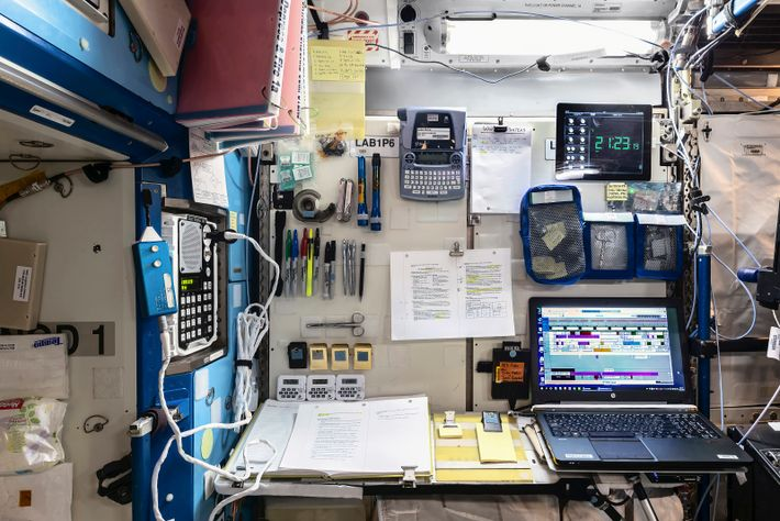 A crew work desk in the U.S. Destiny laboratory. Due to the zero gravity environment, every item ...