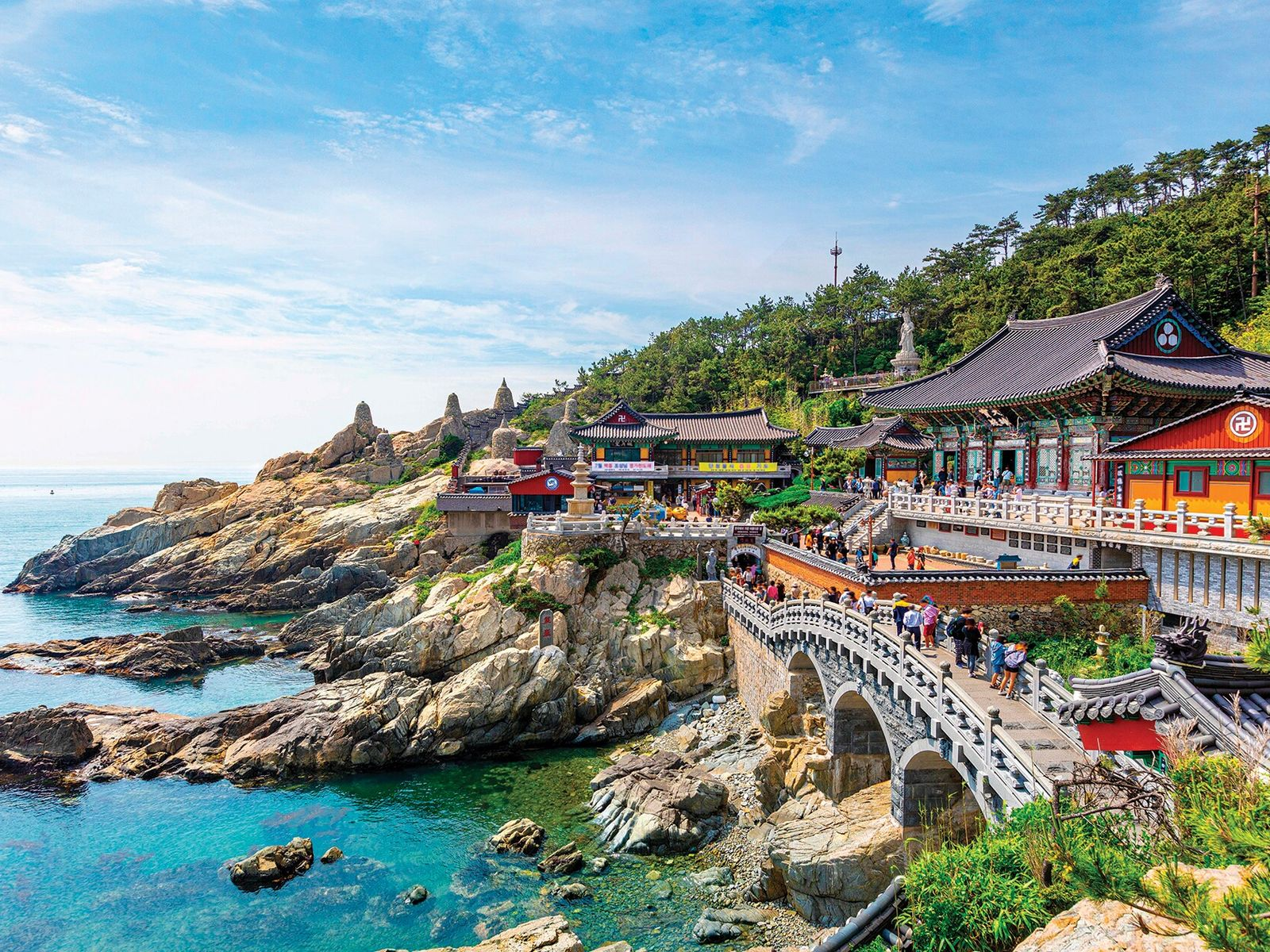 From its rocky perch above the shore, Haedong Yonggung Temple watches over the East Sea like ...
