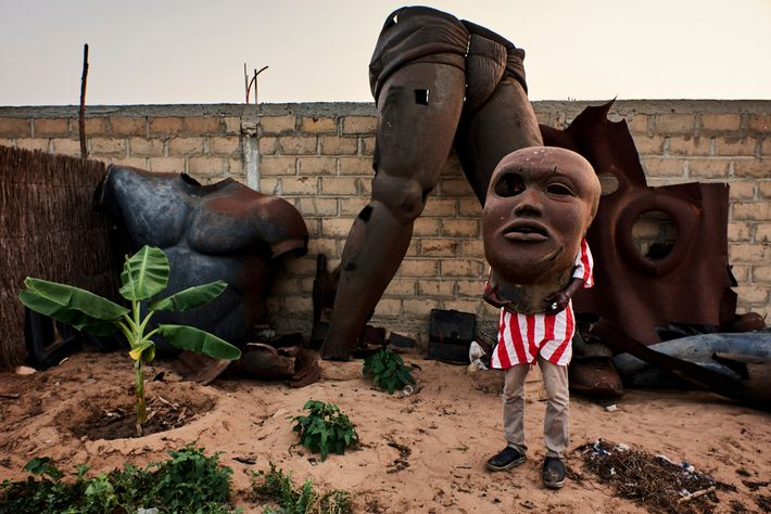 A statue of the Senegaese wrestling legend Yekini lays disassembled in a garden in Bambilor. Yekini ...